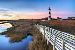 Bodie Island Lighthouse Cape Hatteras North Carolina. Bodie Island Lighthouse, with renovated fresnel lens, at daybreak in an autumn blue hour at the Cape Stock Images