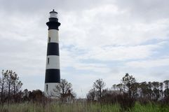Bodie Island Lighthouse, NC, USA. Bodie Island Lighthouse and keeper`s quarters in Cape Hatteras National Seashore, south of Nags Head, North Carolina, USA stock photos