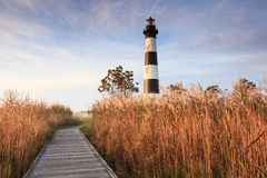 Bodie Island Lighthouse Outer Banks North Carolina NC. Boardwalk leading through the marshes to the Bodie Island Lighthouse on Cape Hatteras National Seashore in royalty free stock photography