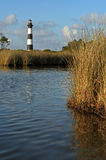 Bodie Lighthouse. The Bodie Lighthouse in North Carolina framed by sea grass. Taken at dusk stock photography
