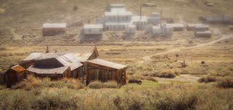 Bodie State Park in California. Village in Bodie Historic State Park in California. Wooden buildings in foreground Royalty Free Stock Images