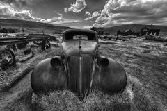 Bodie. Wreck of a ancient rusty car in a ghost town of Bodie. Bodie is a National Historic Landmark. It is located in Mono County, Sierra Nevada - California Stock Images