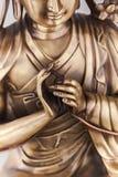 Bodkhisattva Avalokiteshvara sits in a pose of meditation. Stock Images