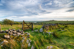 Bodmin Moor in Cornwall. A wooden gate on Bodmin Moor in Cornwall, leading out to Siblyback lake and Tregarrick Tor in the far distance Royalty Free Stock Photos