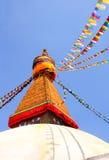 Bodnath stupa and prayer flags in Kathmandu, Nepal Stock Photos