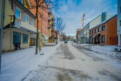 Bodo, Norway - April 09, 2018: Outdoor view of empty the streets of Bodo, during winter covered with snow the sidewalk