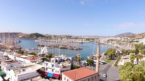 Bodrum city center, white houses, marina, mosque and minaret drone shot Mugla TURKEY. Bodrum city center, white houses, marina, mosque and minaret drone shot stock video footage