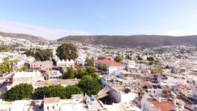Bodrum city center, white houses, marina, mosque and minaret drone shot Mugla TURKEY stock video
