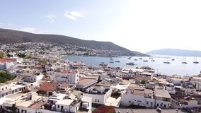 Bodrum city center, white houses, marina, mosque and minaret drone shot Mugla TURKEY stock footage