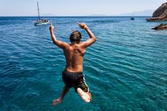 BODRUM, TURKEY - JULY 23: Unidentified boy jumping into sea from Stock Photography