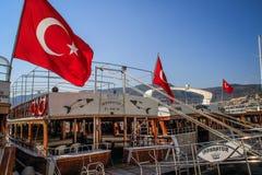 Turkish flags evolve on yachts at sunset stock photos