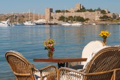 Sea view restaurant in Bodrum. BODRUM / TURKEY - MAY 2015: Sea view restaurant in Bodrum, Turkey royalty free stock photo