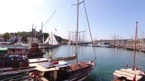 Bodrum, TURKEY - October 2016: Marina castle aerial yacht business boat harbor luxury tourism coastline travel drone shot Mugla stock footage