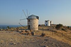 Free BODRUM, TURKISH - JULY 03, 2020: Windmills On The Mountain Stock Photography - 189932652