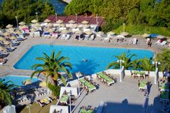 Big Outdoor Luxury Pool Area in a Big Hotel. Bodum ,TURKEY-15.07.17-Big Outdoor blue pool with palms,sunbeds and umbrellas royalty free stock images