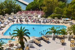 Big Outdoor Luxury Pool Area in a Big Hotel. Bodum ,TURKEY-15.07.17-Big Outdoor blue pool with palms,sunbeds and umbrellas stock photo