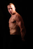 Body. Athlete man showing muscles, health and fitness concept, dramatic light stock photos