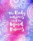 The body achieves what the mind believes. Motivational quote on purple watercolor texture with hand drawn indian Stock Image
