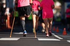 The body affected is running a marathon. Amputation of the leg royalty free stock photos