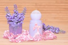 Body antiperspirant deodorant roll-on with flowers in the cap Stock Photos