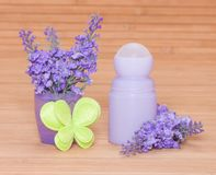 Body antiperspirant deodorant roll-on with flowers and felt butt Stock Photos