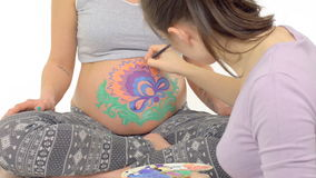 Body art on the belly of pregnant woman stock video footage