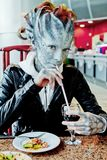 Halloween. Fantasy woman dragon on the street Stock Photography
