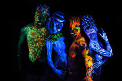 Body art glowing. In ultraviolet light Stock Photos