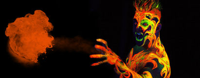 Body art glowing in ultraviolet light royalty free stock images