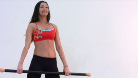 Body Bar Exercise. Slow motion. Young woman with gymnastic stick stock video