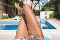 Body of a beautiful girl on swimming pool Stock Photography