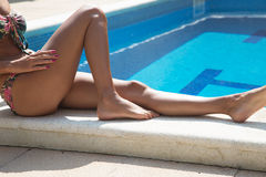 Body of a beautiful girl on swimming pool Stock Photo