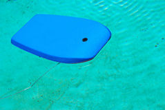 Body board floating in pool Royalty Free Stock Photos