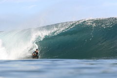 Body boarder riding large wave. Professional body boarding Jeff Hubbard riding large pipeline wave in Hawaii Stock Photos