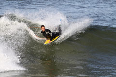 Body boarder riding wave. Young male body boarder riding large ocean wave Stock Photography