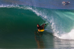 Body Boarding Hollow Waves Stock Image