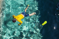 Body of a boy in the pool Stock Images
