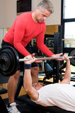 Body buidling exercise at gym Stock Image