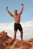 Body builder. Muscular body builder man in black shorts Stock Photography