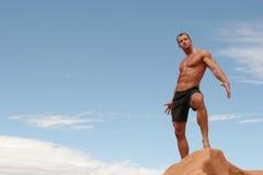 Body builder. Muscular body builder man in black shorts Stock Image