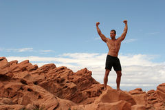 Body builder. Muscular body builder man in black shorts Royalty Free Stock Images