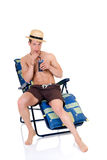 Body Builder, beach chair Royalty Free Stock Photos