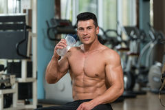 Body builder Drinking Water From Shaker Stock Photo