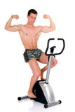 Body Builder, fitness bike Stock Photo