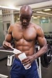Body builder scooping up protein powder Stock Photo