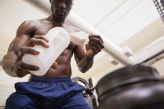 Body builder scooping up protein powder Royalty Free Stock Photo