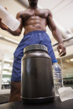 Body builder scooping up protein powder Stock Photography