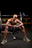 Body Builder. Weight lifter sitting at the bench press about to lift a barbell Stock Photo
