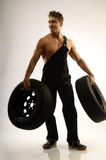 Body-building. A man with two car tires Royalty Free Stock Images