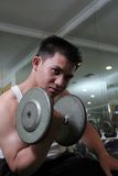Body building. Man lifting barbell in fitness center Stock Photo